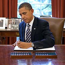 President Obama Signs Law To Raise U.S. Debt Ceiling